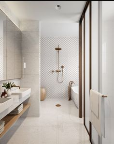 Feature tile and brass shower head | bathroom