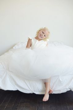 White and ivory first communion and flower girl dresses by Gilly Gray www.gillygray.com