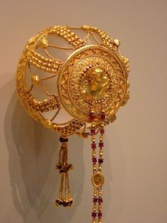 Gold hair ornament with garnets, probably made in Alexandria, Egypt, ca. 220-100 B.C.