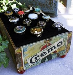 Wonderful idea and love the beads for feet on the cigar box.  Great creativity.