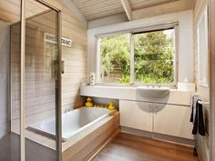 Exposed timber rafters in bathroom. Timber wall cladding. Nautical-ish ambience. Interesting rafter-wall edge detail