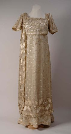 Ball gown, oyster coloured silk satin, with embroidered bodice and beaded overskirt, early 1800's.  Swansea Museum.