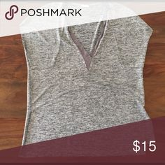 zara grey shimmer v-neck tank grey shimmery v-neck tank that is perfect for summer. the material is dressy and cool - and unfinished ends let you dress up or down. Zara Tops Tank Tops