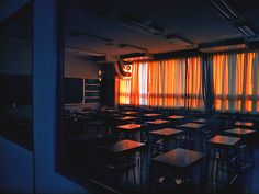 I had been wandering around the school for a while. I came into an empty classroom as the sun was setting. The way the sun shone through the window was beautiful, so I stopped to gaze at it. -Abigail.