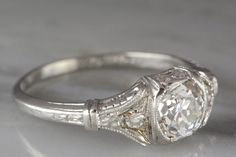 Purchase of this listing serves as the second (final) of two payments. Details can be found in our one-on-one Etsy messaging thread. Date: c. 1920  Movement: Edwardian; early Art Deco  Current size: 6 (please contact us for sizing options)  Materials: Platinum Diamonds: 1.00 ctw (est)  Center: .88 ct (est) Old Mine Cut diamond; I color; VS2 clarity  Accents: .12 ctw (est); six Single Cut diamonds       R622 HYAA