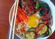 Bibimbap: Besides being fun to say, bibimbap, a classic Korean dish, is comforting and nutritious, incorporating whole grains, proteins and veggies into one steaming hearty dish. Bibimbap can be served hot or cold - my favorite is dolsot bibimbap, which comes served in a sizzling hot stone bowl and topped with a raw egg that cooks as you stir it into the steaming rice. The flavor of bibimbap is unmistakable and unique. It's also easy to recreate at home.