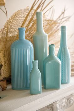 blue Rosanna bottles--I wonder if you could this this color spray-painting clear bottles?