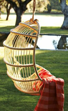 Nothing screams leisurely fun like a hanging chair on the porch or patio. We're drawn to every style from colorful hammock-like silhouettes to retro rattan Outdoor Lounge Furniture, Outdoor Chairs, Indoor Outdoor, Patio Chairs, Rattan Chairs, Outdoor Seating, Outdoor Swings, Balcony Furniture, Porch Swings