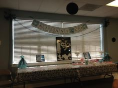 Banner with baby's name and dessert table
