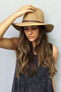 Softly structured jute hat with a contrast leather band wrapped around the crown. Lined with a soft knit sweat band for comfort. -One size fits all
