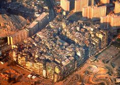 Kowloon Walled City was a former Chinese military fort turned into largely ungoverned settlement in Kowloon, Hong Kong. 33,000 families used to live in 300 buildings. Kowloon Walled City was completely demolished in April 1994.