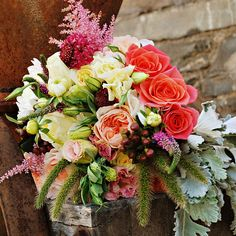 Brides.com: . Arrangement of dahlias, scabiosas, astilbe, veronicas, lisianthuses, hypericum berries, roses, dusty miller, and millet. Bouquet by Blossom and Branch