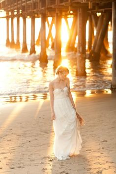 Love this beach/pier shot by Sweet Little Photographs. Great positioning with the sunlight beaming through the pier.