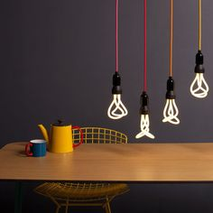 Very cool use of the new Plumen light bulb... love the colorful cords!