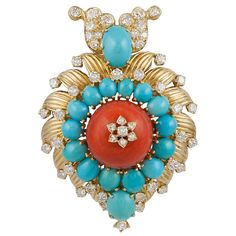 VAN CLEEF & ARPELS Van Cleef & Arpels 18k. gold turquoise, coral and diamond pendant/brooch. Centered by a coral cabochon framed by 17 turquoise cabochons, accented by round diamond weighing approx. 5.50cts. Ca 1970s