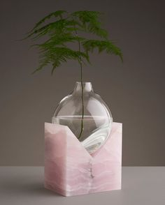 In his Indefinite Vases series, designer Erik Olovsson of Studio E.O juxtaposes smooth, rounded vessels of hand-blown glass against clear-cut geometric slabs of patterned stone. In some of the pieces, the glass appears draped or melted over angled edges of granite and onyx; in others, the bulb-shaped containers sit perched in open slices of marble. The …