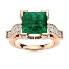 This Emerald engagement ring in 14k Rose Gold sports a princess cut center stone with L shaped prongs with channel set gemstones. Miligrain around the shoulders and the prongs add a bright polish finish and a touch of elegance. Natural Emerald Rings, May Birthday, Love Ring, Princess Cut, Shades Of Green, Vintage Rings, Ring Designs, Tea Party, Channel