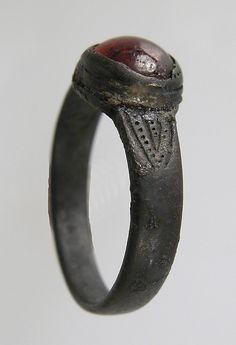 Finger Ring; 7th c, made in Northern France, Frankish  Silver, garnet or glass paste cabochon; Accession Number: 17.192.194