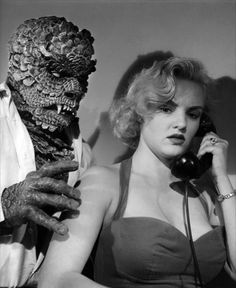 A promotional still for the 1959 film The Hideous Sun Demon featuring Nan Peterson and the monster