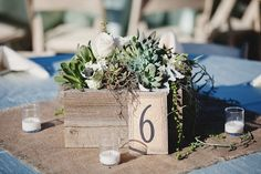 rustic wood centerpiece with succulents and burlap square