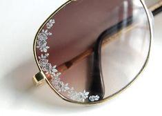 DIY Valentino inspired sunglasses using nail art decals.
