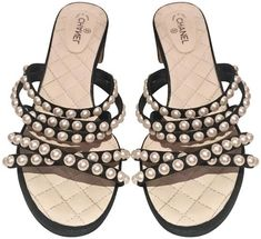 Get the must-have mules of this season! These Chanel Black Pearl Embossed Quilted Cc Slip On 38 Mules/Slides Size EU (Approx. US Regular (M, B) are a top 10 member favorite on Tradesy. Save on yours before they're sold out! Pearl Sandals, Mule Sandals, Black Sandals, Black Heels, Strappy Sandals, Chanel Mules, Chanel Sandals, Chanel Brand, Chanel Logo