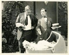 Buster showing off his first son to Eddie Cline