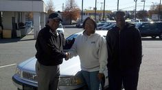 Folger Subaru Sales Consultant Bill Barber with Ms. Wilson and her son and their 2000 Volvo C40!