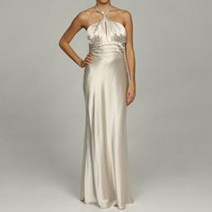 @Overstock - An elegant bandeau halter neckline defines this silky formal gown from Issue New York. This formal dress is finished with a gathered waistband and subtle front bodice keyhole.http://www.overstock.com/Clothing-Shoes/Issue-New-York-Womens-Pearl-Bandeau-Halter-Evening-Gown/5821978/product.html?CID=214117 $115.99
