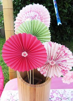 Colourful paper fans are a beautiful detail when displayed as centre pieces in a bamboo vase.  They also make great give-aways.