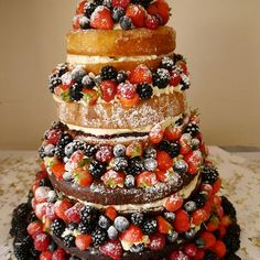 A cake that could give any Bake Off creation a run for its money. This naked 4 tier cake includes a chocolate fudge bottom tier, hummingbird cake second tier, vanilla sponge third tier and finally a lemon drizzle top tier. All covered in fresh berries and icing sugar of course! Thanks Linda Anne Anderson.