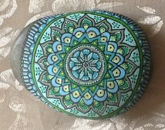 Painted rock for holding down picnic wear