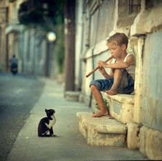 "* * KITTEN: "" Between yer flute notes, kin yoo spare meez a home ? """