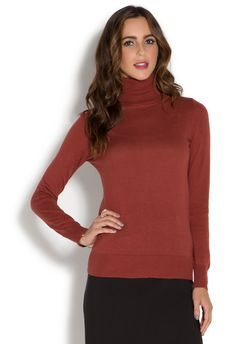 Every fall/winter wardrobe consists of a turtleneck or two. The reason we love having one like this JustFab style is for layering our summer dresses over it to create a cool, fashion-forward look.