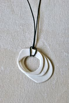 This is a handmade porcelain 3-hoop necklace, which I hand-forged from a slab of Limoges Porcelain*. Despite the wabi-sabi style and soft surface,