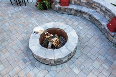 Everything is s'more fun with a Cambridge Pavingstones fire pit. Contractor: Fine Design Landscapes.