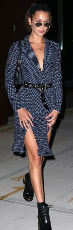 Who mae  Bella Hadid's blue dot dress, boots, belt, and black bag?