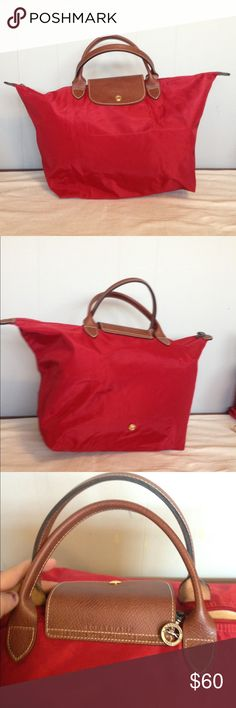 """Red longchamp tote bag Nwot NEver used. Small mark in the bottom hard to see. Short handles I think it's a medium or a large 11""""X18"""" Longchamp Bags Totes"""