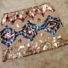 3X HP Aztec Pattern Sequin Skirt Like new - worn once. Gorgeous cream colored skirt with blue, pink, red and gold sequined Aztec pattern. Elastic stretchy waist. Super cute for spring and summer! A must have in every closet! PRICE IS FIRM Hot & Delicious Skirts