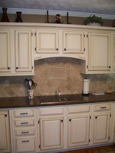 Cream Cabinets With Dark Brown Glaze Like Wall Paint Color Also