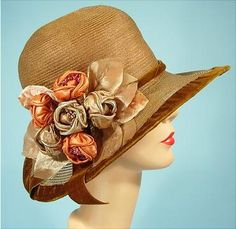 1920s afternoon hat, straw with velvet trim and silk and velvet flowers.