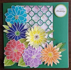 Birthday card by Jennifer Parkes. Designs by Georgina Floral Trio stamps. Flowers coloured with Spectrum Noir Sparkle and Aqua pens.