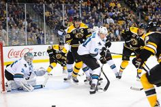 San Jose Sharks defenseman Justin Braun in a sea of Boston Bruins (Oct. 24, 2013).