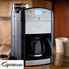 Capresso Coffee Maker with Grinder is fully functional and programmable. It holds up to 10 cups of coffee and has a 5 grind setting on it.
