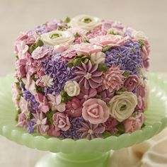 Buttercream flowers in pretty pastels create a garden of sweetness on this cake that's perfect for bridal showers, weddings, Easter or Mother's Day. Showcase your decorating skills using icing colors and the Master Tip Set to recreate this stunning cake.