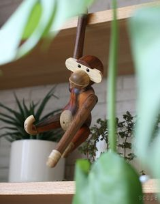 and more specifically the Kay Bojesen little wooden monkey that can hang anywhere for you. This little toy was designed by Kay Bojese. Nordic Interior Design, Scandinavian Home, Cute Designs, Wooden Toys, Denmark, Baby Room, Monkey, Christmas Ornaments, Retro