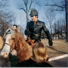 Elvis riding horses at Graceland on February 10th, in 1968.
