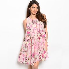 """Beautiful floral mini dress Floral mini dress will keep you cool in the summer and turn heads while it does. NWT retail. L 33"""" B 18"""" W 21"""" 100% polyester. Made in USA. Ark & Co Dresses Mini"""