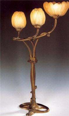 Art Nouveau lamp. Incorporates natural motifs in retaliation to Industrial Revolution and Darwinism. I want at least ONE authentic art nouveau piece in my home.