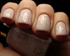Light pink nails with glitter.